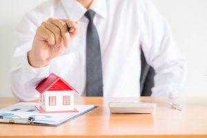 A loan advisor explaining how multiple loans in Singapore can help you achieve home ownership.